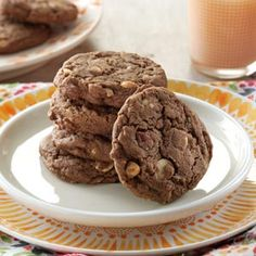 Chocolate Nut Cookies Recipe -Folks are quick to grab one of these cookies when they see they're chocolate. Once they discover the nuts and vanilla chips, they grad a second and sometimes a third. This recipe moved with me from Kentucky to Arizona and now to Ohio!                                        — Farralee Baldwin, Centerville, Ohio