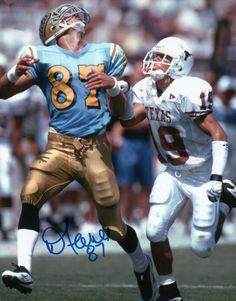 Danny Farmer, UCLA receiver, tries to haul in a long one against Texas. Cool Football Helmets, Football Helmet Design, Ucla Bruins Football, College Football Players, Football Video Games, College Fun, Game Ideas, Coaches, Athletes