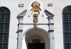 """A church in Sør-Fron Norway God's Name (in English Jehova) written in Latin (""""Iehova"""") above the entrance."""