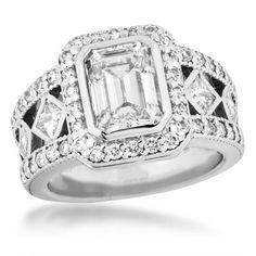 such a unique ring!!! love the emerald cut center!