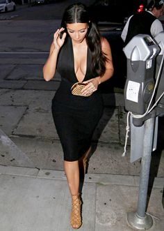 Kim Kardashian Wears Plunging Neckline Look with Kanye West: Sexy Pic - Us Weekly