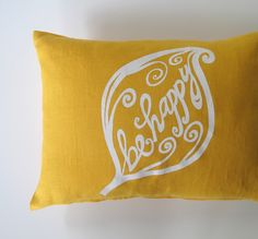 """Pillow Cover Cushion Cover Be Happy on Mustard Yellow Linen 12 x 16"""". $26.00, via Etsy."""