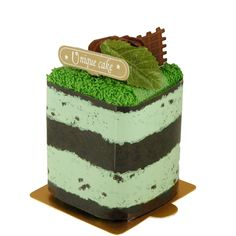 """Mint Cake Towel Size: 2.5""""W x 2.5""""D x 3""""H What goes together better than chocolate and mint? Maybe nothing, except parties and party favors! This Mint Ice Cream Towel Cake party favor is a uniquely-designed party favor with a dessert theme. The bottom begins with a delectable thin layer of chocolate, with rotating layers of mint and chocolate above. This multiple layer ice cream cake slice is topped with a perfect mint leaf, creating a look that is good enough to eat - but wait! This sweet…"""