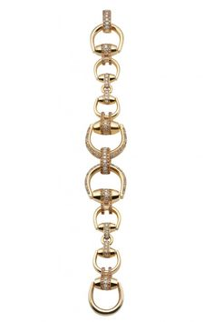 The Gucci Horsebit Beverly collection bracelet in 18kt yellow gold with brown and white diamonds totals 4.86 carats of brilliant cut diamonds. Gucci collection to be unveiled at Zachary's Jewelers Designer Showcase,November 10, Annapolis store. • www.zacharysjewelers.com