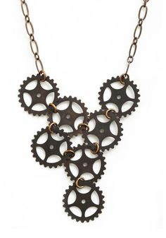 Crafted by Ornamental Things an Austin-based brand that uses materials acquired during designer Natalie Tischler's many travels in order to create sweet and sentimental trinkets this pretty piece consists of charcoal-grey cogs fastened together with brass findings at the end of a grey chain.
