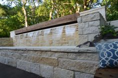 Twenty two foot wide Fountain with Sixteen foot wide waterfall, Cedar Beam and Epi wood bench on one side and Cedar Beam Lintel on other with Austin and Shell Stone