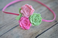 Baby Flower Headband - Rose Trio in Baby Soft Pinks and Mint Green. $6,50, via Etsy.