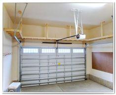 Our Big Shelf - Custom Garage Overhead Storage Installation . We did this with our garage with kayak storage over the cars on a pully system. Garage House, Garage Shed, Garage Tools, Car Garage, Garage Plans, Garage Shoe Rack, Garage Bench, Diy Garage Storage, Garage Shelving