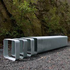 public bench / original design / steel / with integrated bike rack