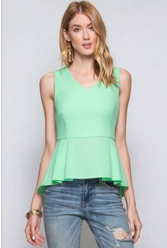 This sleeveless peplum can go from day to night with ease. Beautiful mint color with gold zipper detail on the back. Sweet. Size Guide: Small = 0-2 Medium = 4-6 Large = 8-10