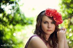 floral headdress with blood orange carnations and moss.  photo by www.jonnyngo.com