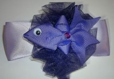Fish is made with grosgrain ribbon and is stacked on a fluffy organdy bow which is stacked on top of a lavender satin bow and is securely attached to a french barrette.If you prefer another type of cl