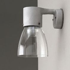 Bathroom fixture DROPPEN-Class I IP23 230V 50HzDescription:  Diecasted aluminium. Chade in clear glass or matt opal glass. The shade is open with incandescent and closed with compact flourescent.Mounting:  On wall.Connection:  Terminal block 3x4mm2. Distance-piece for external mains available as accessory.Design:  Thomas Sandell.