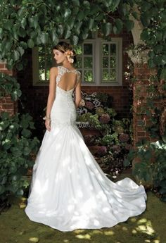 Step into your Secret Garden wedding in romantic luxury and slip on this beautiful bridal gown - your day will surely feel even more captivating by wearing this beauty! Design elements that make this dress such a divine masterpiece include crinkle taffeta with a ruched bodice, embroidered illusion shoulder straps, as well as an open illusion embroidered back. The details on this style are undoubtedly impeccable! With the seemingly limitless wedding gowns there are to choose, finding the perf...