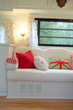 Travel trailer sofa with pillows.