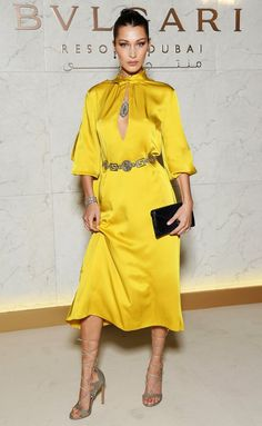 Bella Hadid in a yellow satin midi dress
