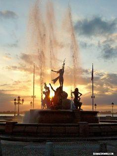 Sunset over San Juan Bay & the Raices Fountain in Old San Juan Puerto Rico.