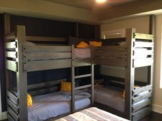 custom corner twin over twin bunk bed with integrated ladder. Made of rustic alder with custom driftwood finish.