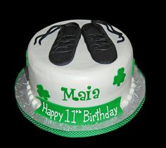 Green shamrock birthday cake topped with irish dancing shoes by Simply Sweets, via Flickr