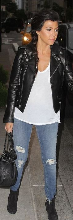 Who made  Kourtney Kardashian's handbag, suede ankle boots, and black leather jacket?