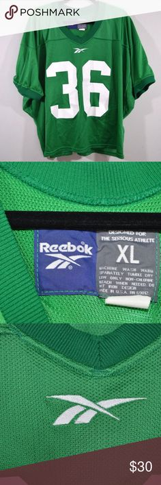 Vtg 90s Reebok Michigan State Football Jersey XL Vintage 90s Reebok Michigan State Spartans Cropped Football Jersey  Excellent jersey  Comes from a smoke-free household  Green and White  The size is XL and the measurements are 30 inches underarm to underarm and 26 inches top to bottom  Check out my other items for sale in my store!  MX Reebok Shirts Tees - Short Sleeve