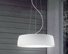 """AXEL - <p style=""""text-align: justify;""""> Circular suspension design that provides diffused illumination from its LED or compact fluorescent light source options. The exterior of this sleek pendant is a compact poluyurethane resin finished is matte or glossy white. Axel also has an internal , opal white polymer diffuser. """" Dual Inside """" version is an option with Blue Tooth and Speaker features.</p>"""