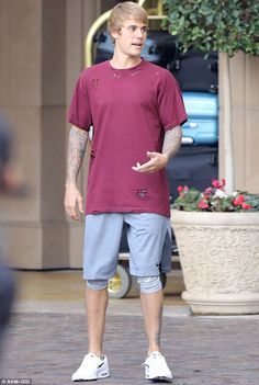 Un-Belieb-able: Justin Bieber's Baby haircut made a dramatic comeback as he headed out to lunch in Beverly Hills on Tuesday