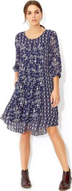 Cute folklore floral dress: Read about traditional embroidery motifs and what they mean at http://www.boomerinas.com/2014/10/03/folk-inspired-clothing-modern-folklore-fashions-fall-2014/