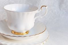 Beautiful Royal Albert Val Dor Footed China Tea Cup and Saucer, England. Both cup and saucer are lovely pure white with a gold trim. Montrose