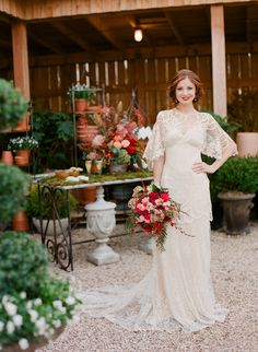 Claire Pettibone 'Amaryllis' wedding dress http://www.clairepettibone.com/bridal/?cp=gowns/amaryllis | Photo: Jen Fariello | Floral: Southern Blooms By Pat's Floral Designs feat. on Style Me Pretty