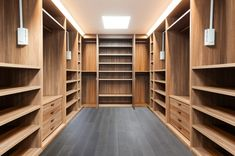 Wide wooden dressing room, interior of a modern house. Notes: A very functional dressing room. May be a bit large for most homes, but concept is important. The room has The post Walk-In Closet and Dressing Room appeared first on Photo Remodeling. Walk In Closet Design, Bedroom Closet Design, Master Bedroom Closet, Closet Designs, Master Bedrooms, Custom Closet Design, Bedroom Wall, Walking Closet, Small Closets