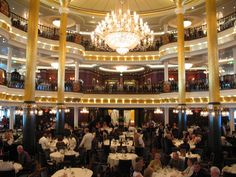 The elegant three-level main dining room aboard Mariner of the Seas.