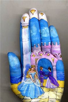 Russian musician and painter Svetlana Kolosova uses her own hand as her canvas as she paints charming little scenes inspired by fairy tales