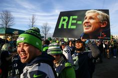 Fans gather along South 188th Street near Seattle-Tacoma Airport to send off the Seattle Seahawks to Super Bowl XLIX. Love this Re-Pete sign!