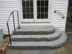 Exterior stone stairs. these are made of granite, but would it be possible to do something similar to our back door?