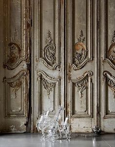 Glass chandelier on floor with ornate rococo style distressed wooden panelled wall -- from John Day LOVE THE DOORS Chandelier Bougie, Glass Chandelier, Chandeliers, French Interior, French Decor, Interior Design, Villefranche Sur Mer, French Grey, French Chic