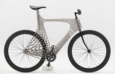 A team of TU Delft students designed and 3D printed a stainless steel bicycle frame to demonstrate the potential of this new method of 3D printing. The students prove the frame's strength by riding the bicycle on the bumpy cobblestone in the city of Delft.