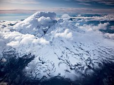 Iliamna Volcano, Alaska  Photograph by Michael Melford, National Geographic    This Month in Photo of the Day: Photos From New National Geographic Books    Clouds scrape by the snow-covered Iliamna Volcano, which last erupted before Europeans settled in the area.    (From the National Geographic book Hidden Alaska by Michael Melford)