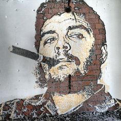 Che Guevara Carved Out from the Rubble: As a street artist with one of the most eccentric techniques, Vhils aka Alexandre Farto is back with another stunner he just completed for Switzerland's Festival Images in Vevey. His latest subject is Cuba's revolutionary icon Che Guevara. If you're not familiar with Vhils' technique, he uses drills, chisels and hammers to chip away at walls, using the negative space to shape his portraits.