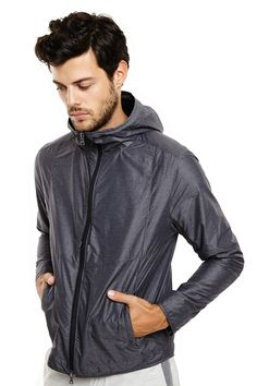 2d48e3b916f6e Well-constructed from lightweight heathered nylon, the Parker is the ideal  zip-up
