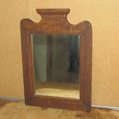 A NICE 19TH C GRAIN PAINTED FOLK ART COURTING MIRROR IN THE BEST ORIGINAL PAINT FINE DECORATED RED AND MUSTARD GRAIN PAINT NICE CREST.   Sold  Ebay   207.00