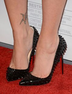 Black spiky pumps, arches,  and toe cleavage