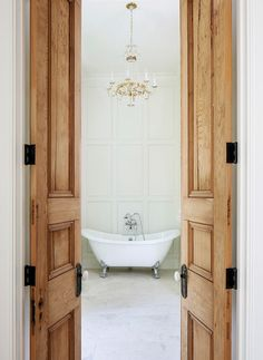 Reclaimed Interior Doors - made from old growth cypress - Tailored Family Home with Neutral Interiors
