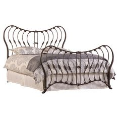 Transform your master suite into a resort-worthy retreat with this striking wrought iron bed, featuring a rustic pewter finish and fleur-de-lis accents for c...