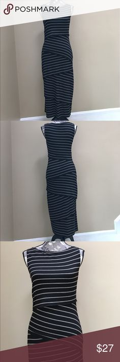 """Bailey44 Striped Column Maxi Dress Bailey44 Black and Tan striped column maxi dress size medium. Form fitting and very slimming on. Excellent condition. Lined. 96% rayon and 4% spandex. Each layer of the striped soft stretch jersey knit creates a flattering shape and look. Perfect dress for dress up or a casual night out. 16"""" from underarm to underarm and 46"""" long. Anthropologie Dresses Maxi"""