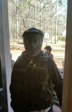 Laken all dressed in his combat gear on his 13th birthday party. ,how would you like opening your door to this! Fun times for the guys