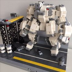 My first mech and attempt to add scale. Key pieces / sets: Architecture Studio, 1x2 fork / stub plates for the joints, angle plates 1X2 / 2X2 for sideways building