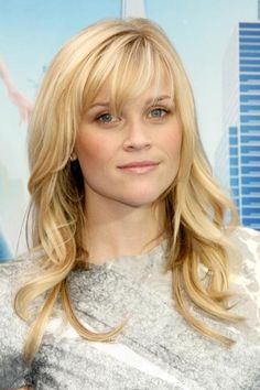 Curls liven up any hairstyle, especially soft waves. Plus, they can counter the sharp edges of modern dresses like this one. #hairstyles #ReeseWitherspoon