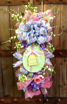 Designed with pink burlap with pastel colors. Hydrangeas, ribbons, eggs, sweet pea, and an easter plaque all brought together to make a festive swag for your door! Easter Projects, Easter Crafts, Easter Ideas, Easter Decor, Easter Wreaths, Spring Wreaths, Summer Wreath, Deco Mesh Wreaths, Burlap Wreaths