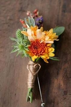 If you are using traditional oranges and yellows for your fall wedding palette, you can always be a little bit playful with boutonnieres and incorporate the colors cheerfully, such as with this heart-accented boutonniere.